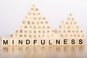 mindfulness spelled with Scrabble cubes