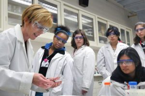 six people in lab coats