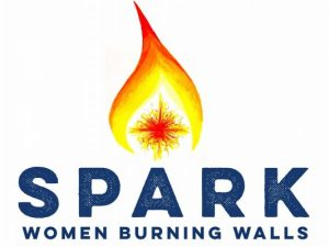 SPARK logo, a red, orange and yellow flame atop the word spark in blue. Under spark are the words women burning walls.