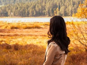 A person looking out onto a natural landscape