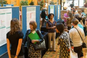 a groups of people look at presentation posters