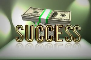 Money alongside the word success