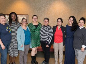 Colorado State University Women of Color Event Planning Committee members Shannon Archibeque-Engle, Angelica Murray, Kathy Sisneros, Priscilla Gardea, Ria Vigil, Maricela DeMirjyn, Cori Wong and Carmen Rivera gather for a group photo, March 26, 2018.
