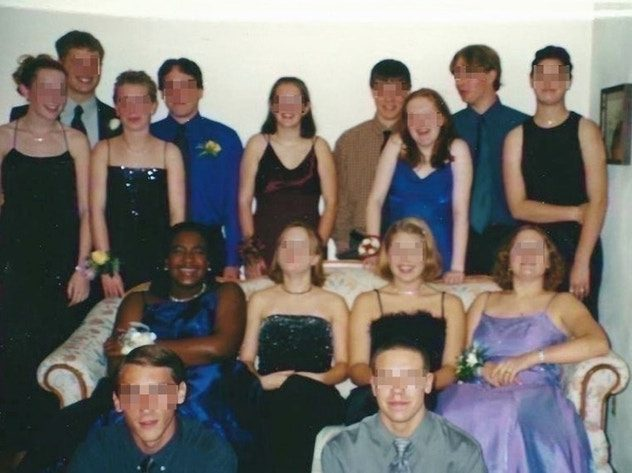 group of teenagers smiling at the camera before a school dance