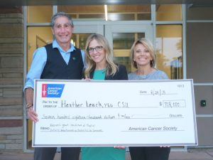 Left to right, Barry Braun, Heather Leach, and Missy Wright . Wright represents the North Region of the American Cancer Society and surprised Leach with a check presentation for her grant