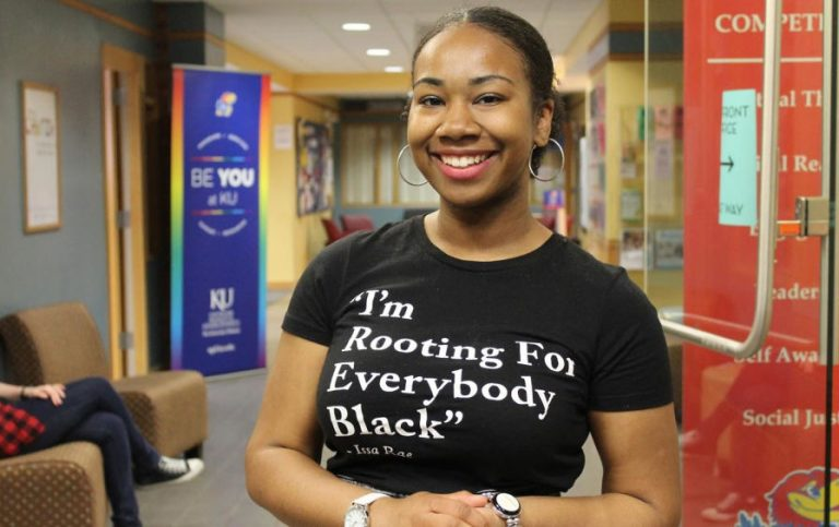"woman wearing shirt that says ""I'm rooting for everybody Black"" - Issa Rae"