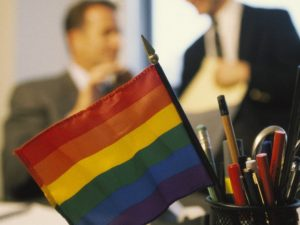 Pride flag in a pencil holder on a desk