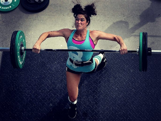 Woman lifts weights
