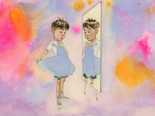 a child holding a dress looks in the mirror