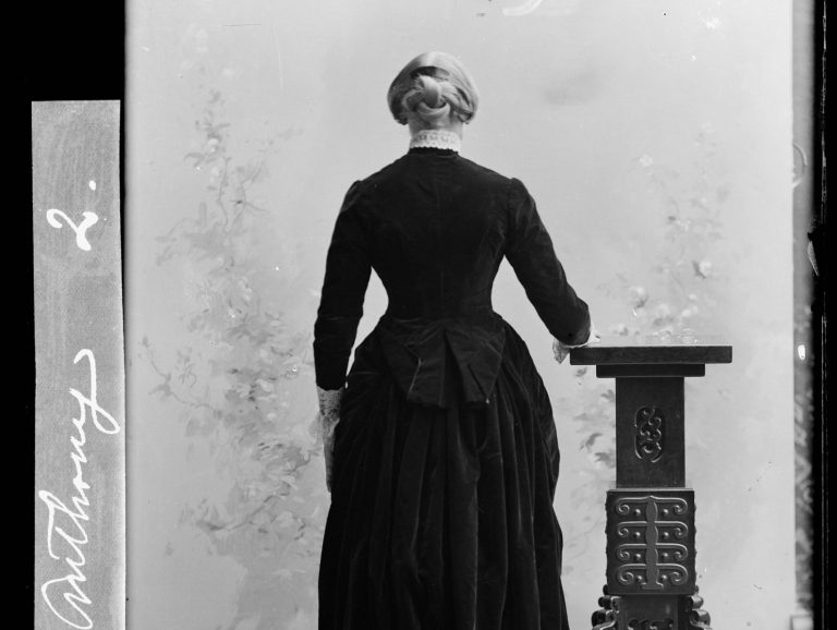 Susan B. Anthony posing for a picture with her back turned towards the camera