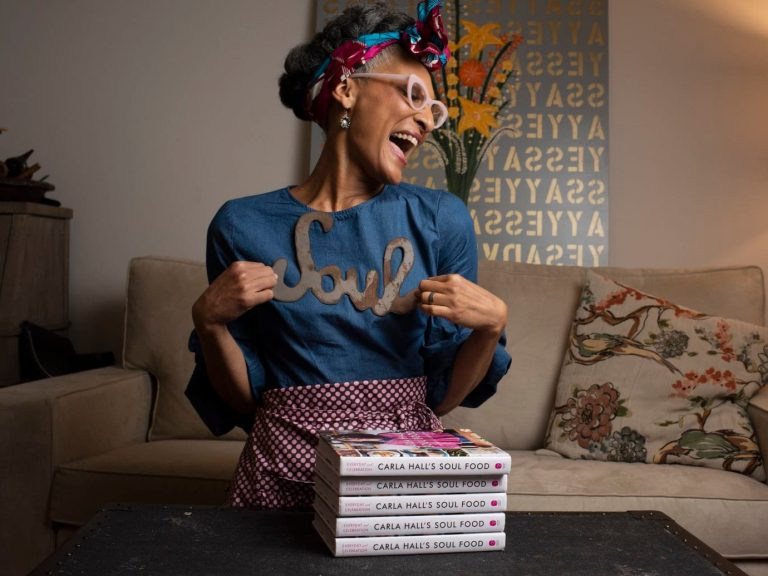 Carla Hall with her new book