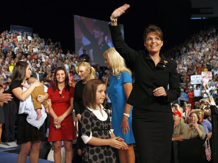 Sarah Palin stands on stage with her family