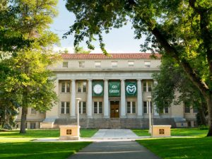 """The Administration Building has a """"Go Green"""" banner hanging in honor of the new students. August 21, 2013"""