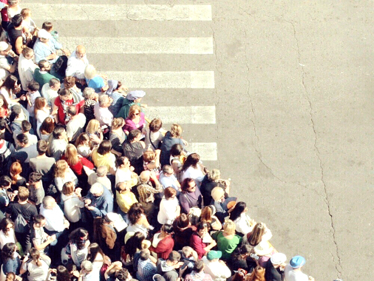 people waiting to cross the street