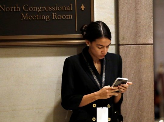 Incoming Representative Alexandria Ocasio-Cortez waits for a House of Representatives member-elect welcome briefing on Capitol Hill in Washington, U.S., November 15, 2018. REUTERS/Yuri Gripas - RC1FFDA9C510