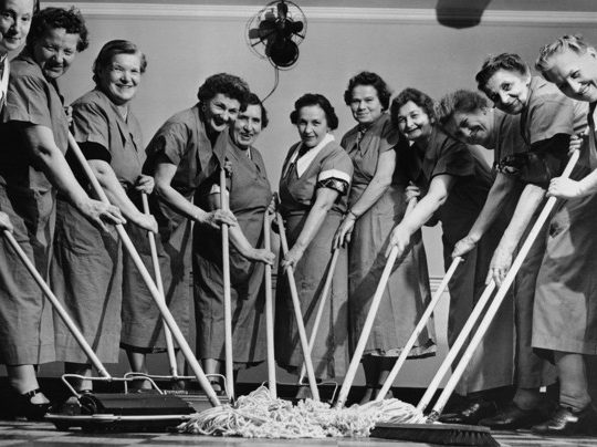 black and white picture of women mopping