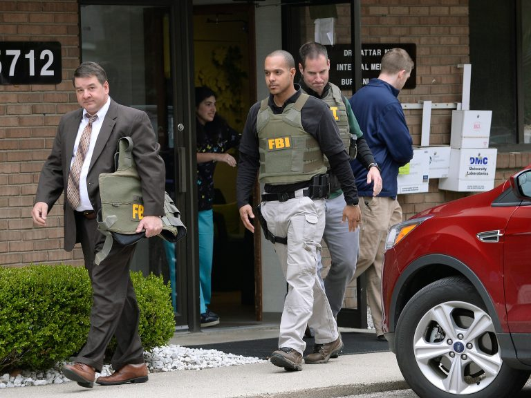 FBI agents exiting the office of Dr. Fakhruddin Attar in Livonia, Mich., last year. Dr. Attar and Dr. Jumana Nagarwala were defendants in a case struck down by Judge Bernard Friedman.