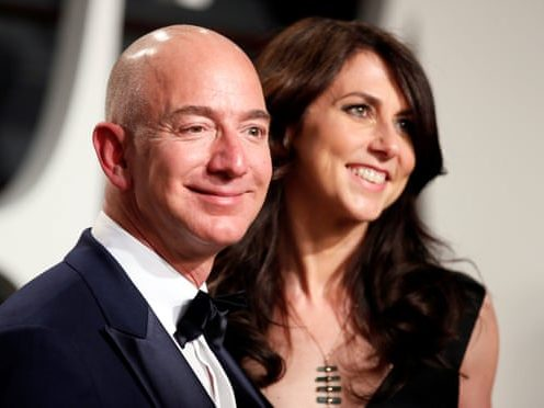 MacKenzie and Jeff Bezos smile at an event together