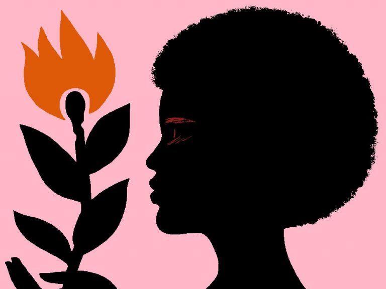 image of a black women holding a flower