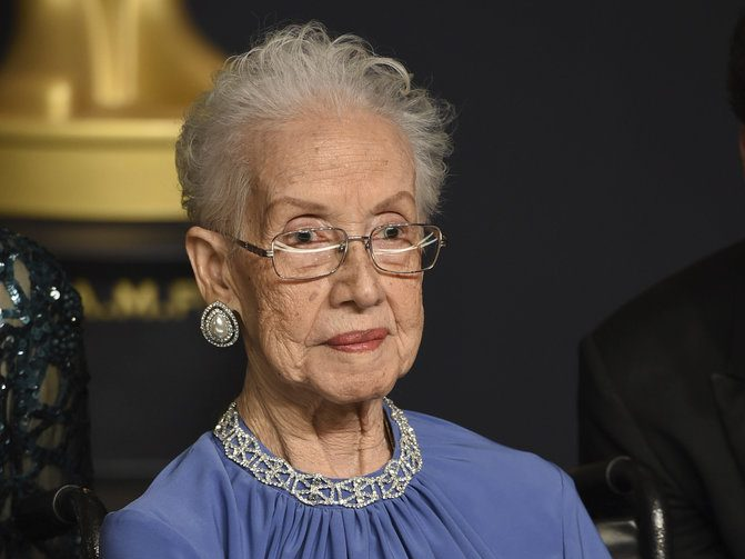 "In this Feb. 26, 2017, file photo, Katherine Johnson, the inspiration for the film, ""Hidden Figures,"" poses in the press room at the Oscars at the Dolby Theatre in Los Angeles. Johnson, the NASA mathematician whose calculations helped bring Apollo astronauts back to Earth, is being honored at her alma mater with a bronze statue and a scholarship in her time. West Virginia State University says a dedication ceremony is planned for Aug. 25, 2018, the day before Johnson's 100th birthday. (Photo by Jordan Strauss/Invision/AP, File)"