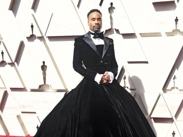 Billy porter on the red carpet wearing a black ballgown