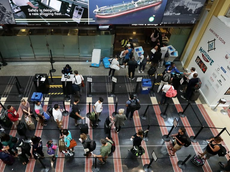 people standing in line at an airport
