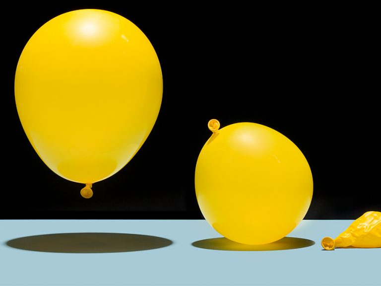 three yellow balloons