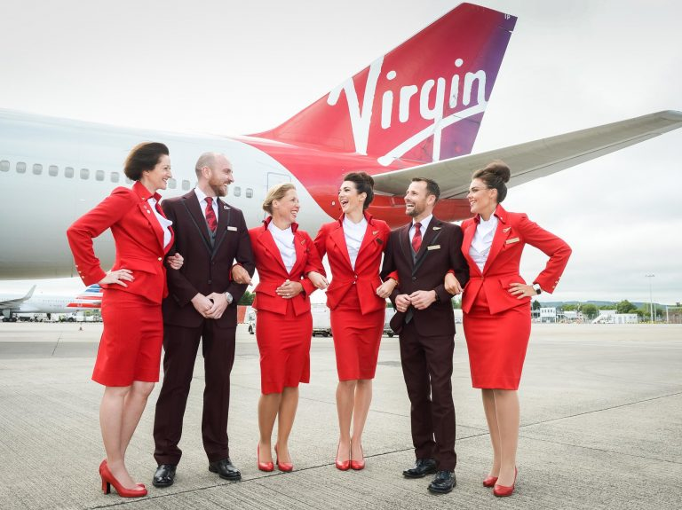 flight attendants in front of a plane