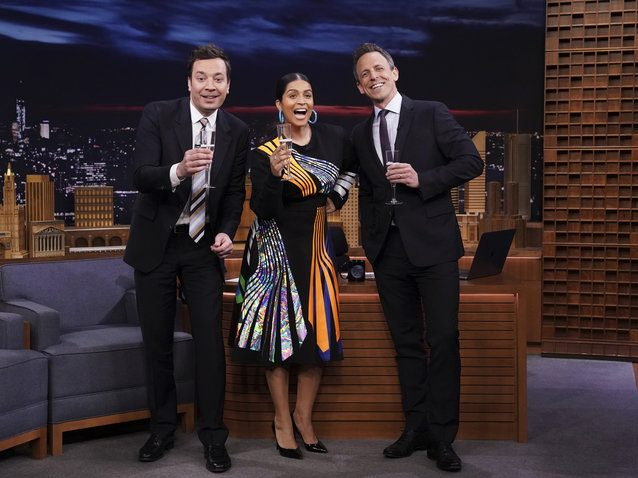 Jimmy Fallon, Lilly Singh and Seth Meyers celebrating Singh's new late-night show on Thursday.