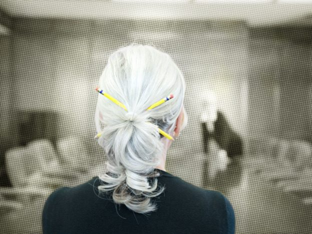 woman with white hair in an office
