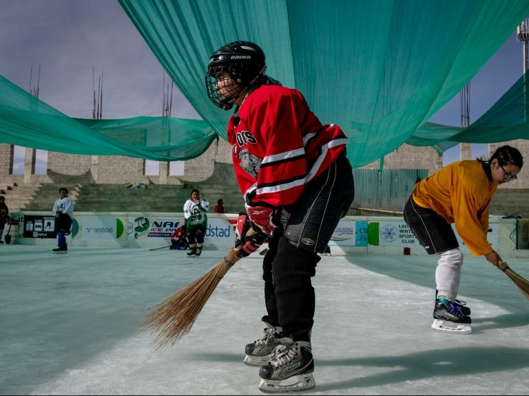 woman playing hockey