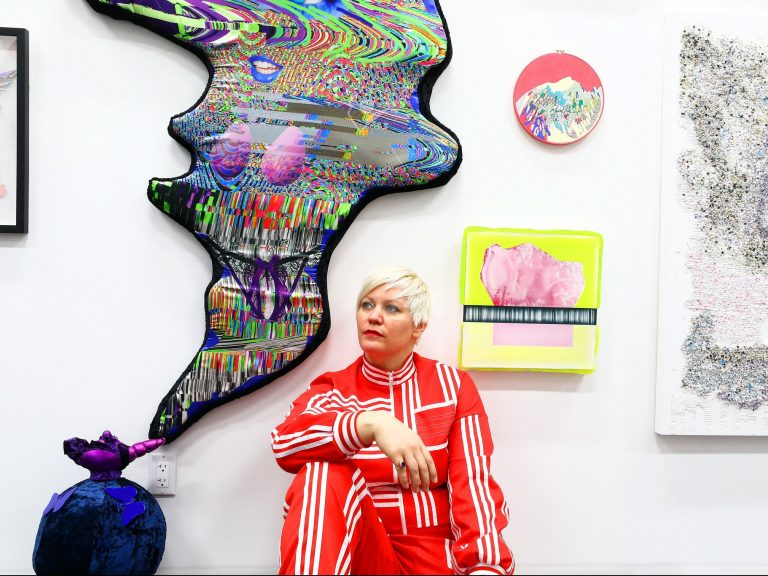 The artist C. Finley, organizer of the Every Woman Biennial, in front of works by Deming Harriman, Florencia Escudero, Cynthia Alvarez, Amy Vensel and Valincy-Jean Patelli that are part of the exhibition.CreditCredit