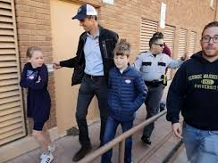 Beto O'Rourke and his children Molly (left) and Ulysses leave their neighborhood polling place after voting on November 6, 2018, in El Paso, Texas.