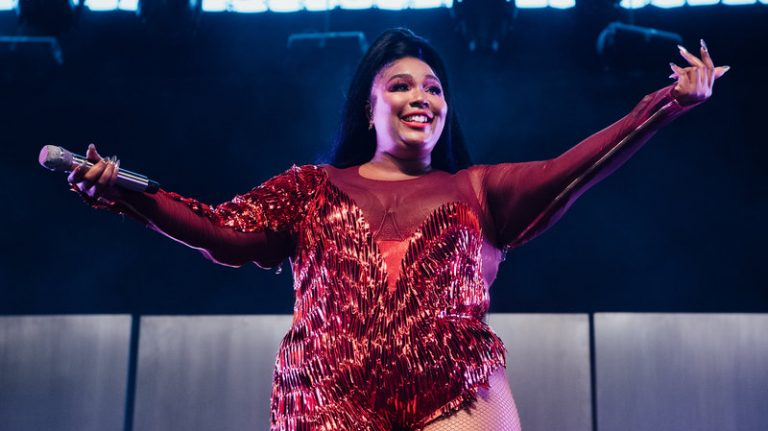Lizzo performs onstage at Coachella on April 21 in Indio, Calif. The flute-playing singer and rapper celebrates self-acceptance on her latest album, Cuz I Love You.