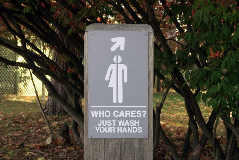 "sign that reads ""gender: who cares? just wash your hands"""