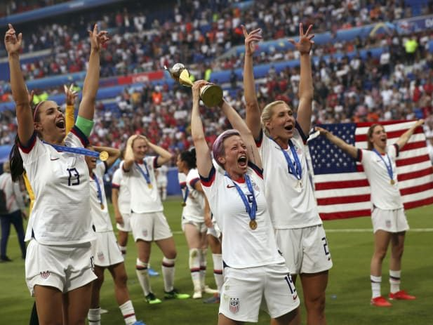 United States' Megan Rapinoe (center) holds the trophy as she celebrates with teammates after they defeated the Netherlands 2–0 in the Women's World Cup final soccer match.