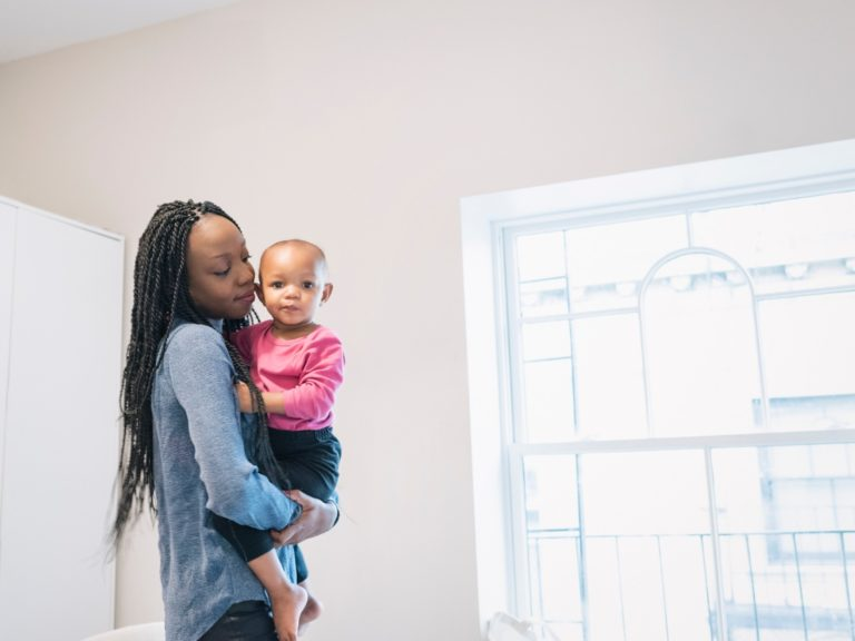 black woman holding her child