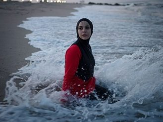 woman in hijab swimming
