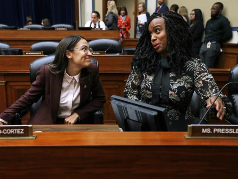 Rep. Alexandria Ocasio-Cortez (D-NY) (L) and Rep. Ayanna Pressley (D-MA) in the Rayburn House Office building on Capitol Hill in July 2019 in Washington, DC.