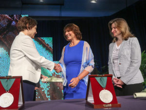 Margarita Lenk accepts the AAA/J. Michael and Mary Anne Cook/Deloitte Foundation Prize from University of Alabama accounting professor Mary Stone (left) and Kathy Shoztic, executive director of the Deloitte Foundation.