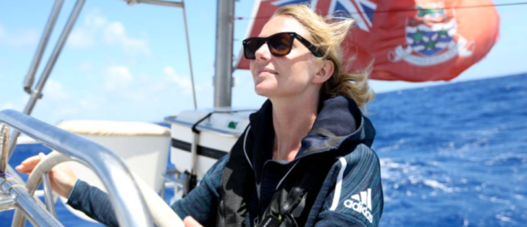 Emily Penn, mission director of eXXpedition Round the World, is seen at the helm during the organisation's North Pacific voyage in June 2018.