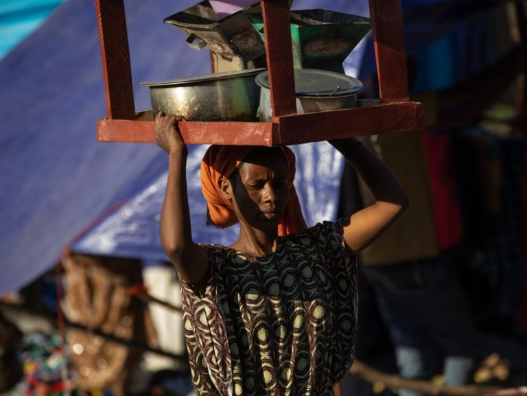 woman carrying items on her head