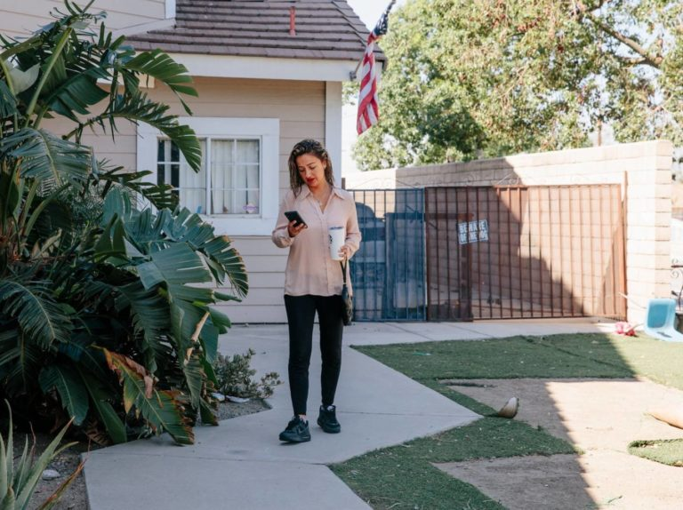 "Brandy Powell outside her home in Fontana, Calif., before heading to work. ""They expect you to always say yes,"" she said of employers who change her schedule on short notice.Credit..."